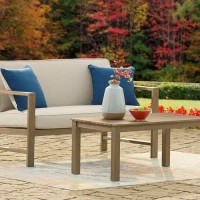 Fynnegan Light Brown Loveseat with Table (Includes 2)